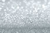 stock photo of xmas star  - Abstract silver defocused glitter background with copy space - JPG
