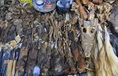 stock photo of voodoo  - Voodoo objects for sale in a fetish market used for traditional medicine in West Africa - JPG