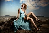 stock photo of diva  - Portrait Of Fashion Woman In Blue Dress Outdoor - JPG