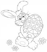 foto of cony  - Funny rabbit friendly smiling and carrying a colorfully painted Easter egg - JPG