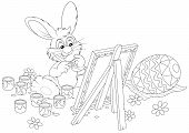 stock photo of cony  - Funny rabbit drawing a colorful Easter egg to the upcoming holiday - JPG