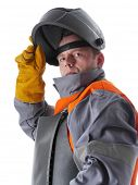 Portrait of welder wearing protective suit and welding hood on white