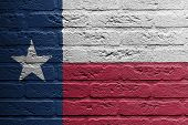 image of texas star  - Brick wall with a painting of a flag isolated Texas - JPG