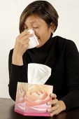 picture of blowing nose  - Asian woman sneezing or blowing her nose - JPG