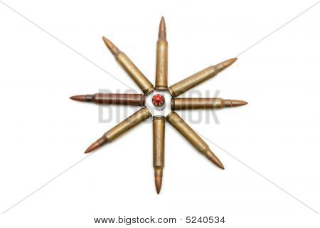 Eight-pointed Star Made Of M16 Cartridges Isolated