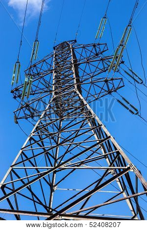 High Voltage Electricity Pylon Against Blue Sky