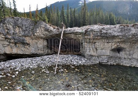 Cave along a River Bank