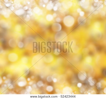 Soft blurry bokeh space background of golden yellows.Autumn colors