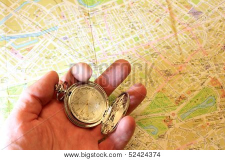clock and geographical map