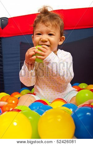 Happy Baby With Colorful Balls