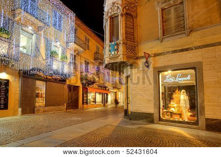 ALBA - DECEMBER 05: Popular touristic street in old city with stores, restaurants and shops illuminated and decorated for Christmas and New Year holiday in Alba, Italy on December 05, 2012.