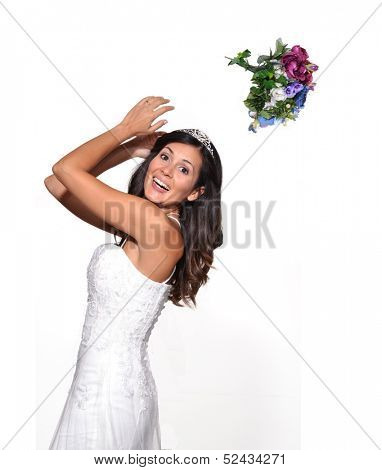 Happy bride throwing up a flowers bouquet.