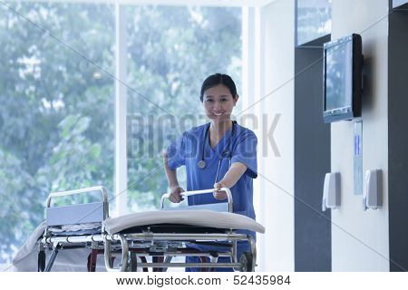 Nurse wheeling empty stretcher in the halls of the hospital