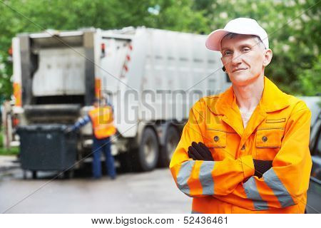 Portrait of municipal worker recycling garbage collector truck loading waste and trash bin