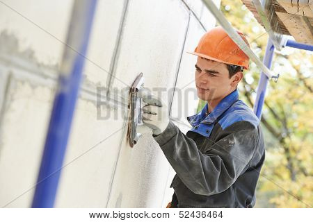 builder worker facade building with sandpaper