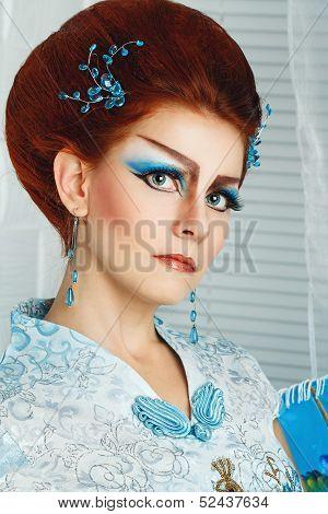 Geisha In A Smart Dress