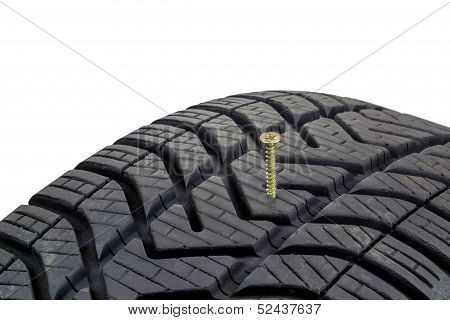 A screw stuck in a car tyre