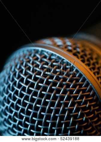 Vocal Microphone Macro Over Dark Background