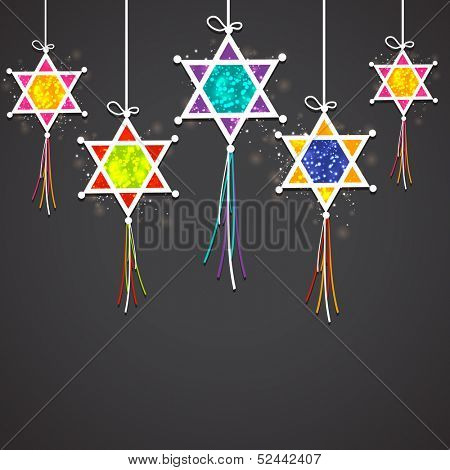 Indian festival of light Happy Diwali concept with hanging colorful decorative on black background.