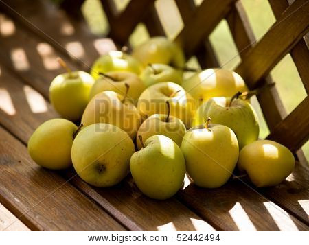 Apples on a old brown wooden bench