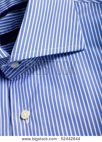 A part of a blue laced shirt with buttons