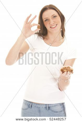 Young Woman Holding Typical Dutch Candy Pepernoten Isolated On White Background