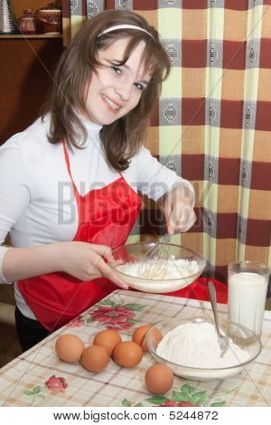 Young Women Doing An Omelet