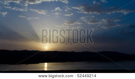 Sunset  sunrise with clouds, light rays and other atmospheric effect