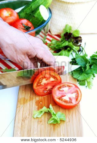 Man Cuts Ripe Tomatoes For Summer Vegetable Salad