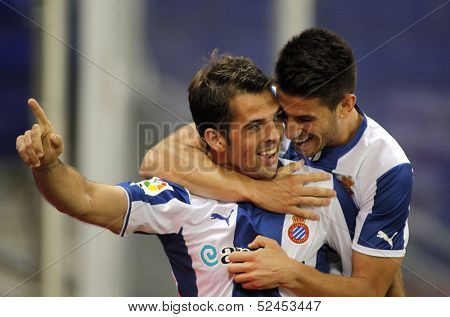 BARCELONA - SEP, 23: Victor Sanchez(L) and Luis Pizzi(R) of RCD Espanyol celebrating goal during a Spanish League match against Bilbao at the Estadi Cornella on September 23, 2013 in Barcelona, Spain