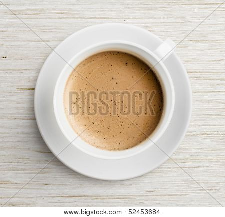 coffee cup with foam  on table top view