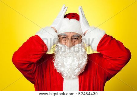 Stressed Out Santa Pressing Against His Temples