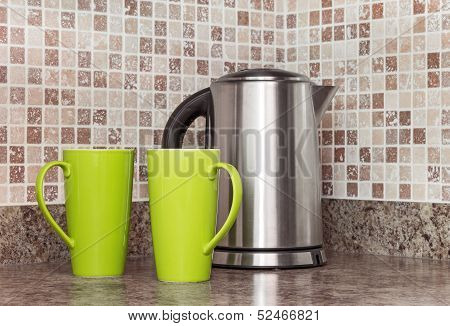 Electric Kettle And Cups In The Kitchen
