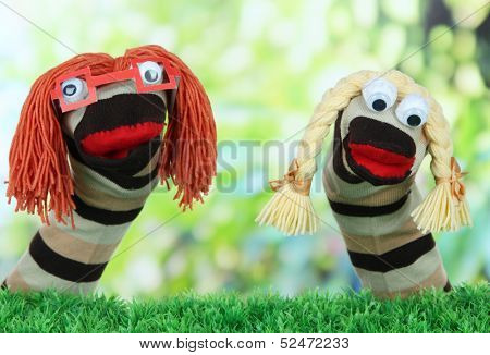 Cute sock puppet on bright background
