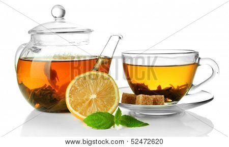 Cup and teapot of green tea with lemon and sugar isolated on white