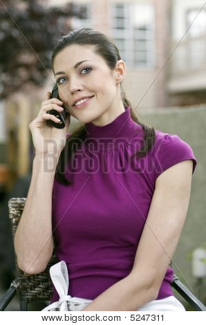 Young Beautiful Woman Talking On The Phone