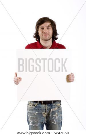 Close Up Of A Casual Young Man Presenting A Blank Board