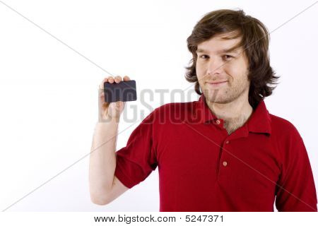 Close Up Of A Casual Young Man Presenting A Blank Card