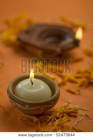 A candle in an indian earthen holder