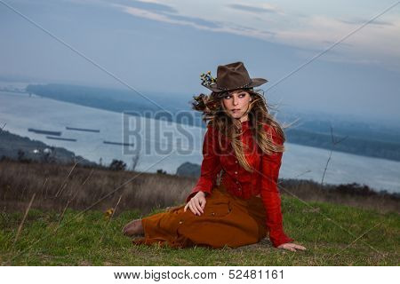young blonde woman in autumn fashion clothes,  red leather jacket, hat, cashmere scarf and brown skirt outdoor shot