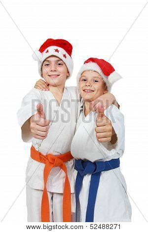 Two athletes in the cap Santa Claus show finger super