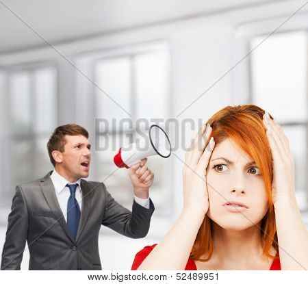 business, communication, hiring, searching, public announcement, office concept - buisnessman with bullhorn or megaphone and stressed woman