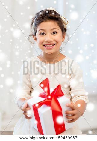 holidays, presents, christmas, x-mas, birthday concept - happy child girl with gift box