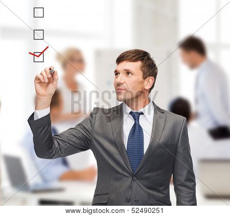 business and office concept - attractive buisnessman or teacher with marker
