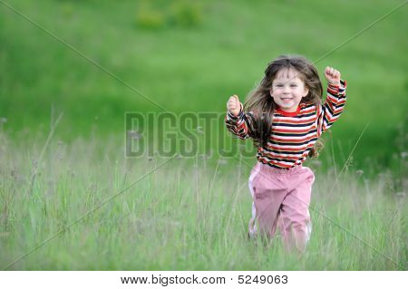 The Running Girl On A Green Field