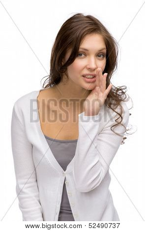 Portrait of whispering girl, isolated on white. Concept of secret and mystery
