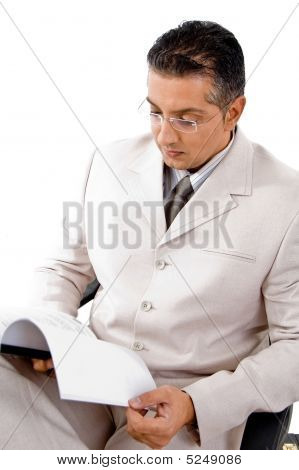 Top View Of Businessman Looking In To File