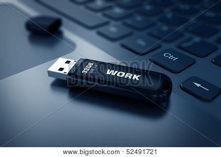 Modern USB Flash drive on laptop keyboard