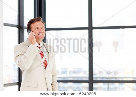 Businessman Speaking On A Mobile Phone With Copy-space
