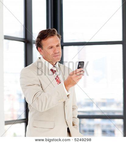 Portrait Of A Businessman Sending A Text On A Mobile-phone